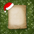 Christmas greeting card with old paper on the green abstract bac — Stock Photo