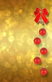 Christmas balls and red bow with bells on abstract snowy backgro — Stock Photo