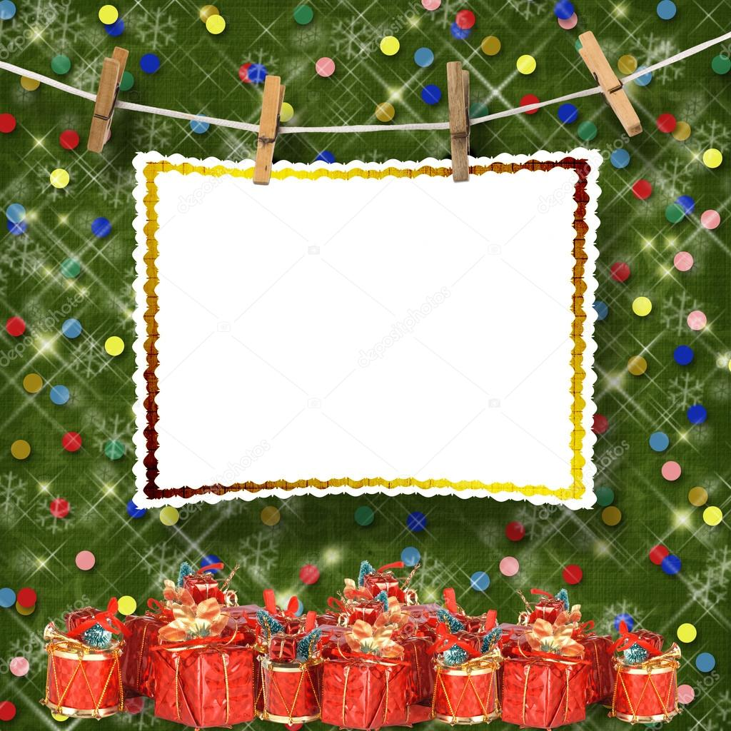 Greeting card hanging on a rope and clothespins  with presents on the abstract sparkling background — Stock Photo #16344523