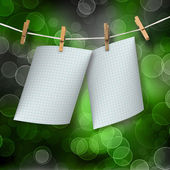Checked sheets hanging on a rope and clothespins on the abstract — Stock Photo