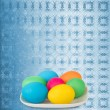 Pastel ornamental background with multicolored eggs in a bowl to — Stock Photo