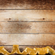 Vintage wooden background with swirling gold braid for holiday - Stock Photo
