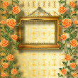 Old wooden frame for photo with garland of painting rose — Stock Photo
