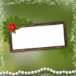 Frame for photo with pearls and bunch of flower — Stock Photo #2287192