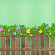 Wooden fence with a flower garland on the abstract background of — Stock Photo #24600125