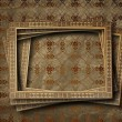 Old grunge frames on the ancient paper background — Stock Photo #24608139