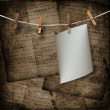 Old sheets hanging on a rope and clothespins on the brown abstra — Stock Photo