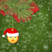Christmas ball in the hat of Santa Claus with pine branches on t — Stock Photo