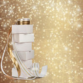 White boxes with gifts with gold ribbon beautiful abstract backg — Stock Photo
