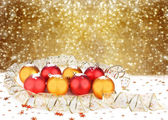 Christmas ball with greeting card on the white isolated backgrou — Stock Photo