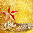 Gold paper horizontal ribbon and Christmas star on abstract snow — Stock Photo