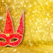 Carnival mask and a red Christmas ball on a golden abstract back — Stock Photo #31025779