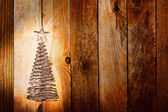 Christmas greeting card with gold metal firtree on the wooden ba — Stock Photo