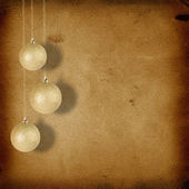 Christmas balls hanging on the old paper background — Stock Photo