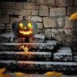 Halloween pumpkins in the yard of an old house at night in the b — Stock Photo #31676587