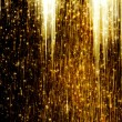 Gold Shooting Stars on abstract dark background — Stock Photo