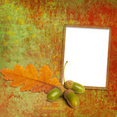 Old grunge frame with autumn oak leaves and acorns on the abstra — Stock Photo