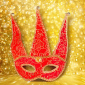 Carnival red mask on gold abstract background with bokeh effect — Stock Photo