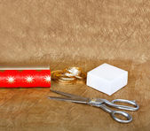 Wrapping paper and boxes for gifts with ribbons and scissors on — Stock Photo