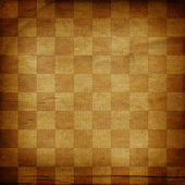 Vintage abstract background with chequered chess ornament — Stock Photo