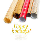 Rolls of multicolored wrapping paper for gifts isolated on white — Stock Photo