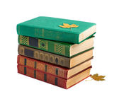 A stack of old books with gold stamping on a white background is — Stock Photo
