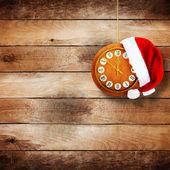 Kerstman hoed op de klok — Stockfoto