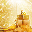 Gift box in gold wrapping paper — Stock Photo #33041471