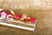 Rolls of multicolored wrapping paper with streamer for gifts on — Stock Photo