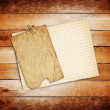 Old sheets of paper on grunge wooden background — Stock Photo #33226405