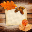Old grunge paper with autumn oak leaves and Gift box on the wood — Stock Photo #33481031