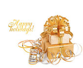 Beautiful Gift box in gold wrapping paper isolated on a white b — Stock Photo