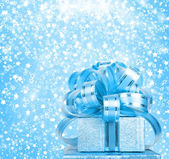 Gift box in blue wrapping paper — Stock Photo