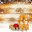 Snow-covered wooden wall with a beautiful gift box and bow — Stockfoto