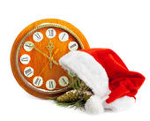 Santa Claus hat, clock and Christmas tree isolated on white back — Stock Photo