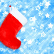 Red christmas boot  on blue abstract background — Photo