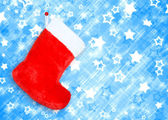 Red christmas boot on blue abstract background — Stock Photo