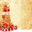 Stock Photo: Gift box in gold wrapping paper