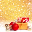 Stock Photo: Gift box in gold wrapping paper on beautiful abstract backgrou
