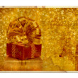 Vintage greeting card with gift boxes and beautiful golden bow — Zdjęcie stockowe