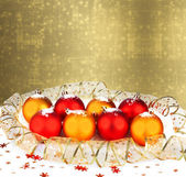 Christmas ball with greeting card on the abstract sparkling back — Stock Photo