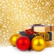 Golden gift box with Christmas balls and garlands of beautiful beads — Fotografia Stock  #35897623