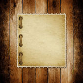Grunge paper for invitation on the vintage wooden background — Stock Photo
