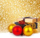 Golden gift box with Christmas balls and garlands of beautiful beads — Stock Photo