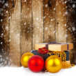 Stock Photo: Golden gift box with Christmas balls and garlands