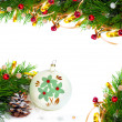 Christmas tree branch with gold serpentine and vintage sphere on — Stockfoto