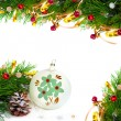 Stock Photo: Christmas tree branch with gold serpentine and vintage sphere on