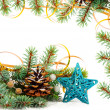 Christmas tree branch with gold serpentine and star on white bac — Stock Photo
