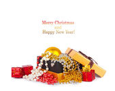 Golden gift box with Christmas balls and garlands — Stock Photo
