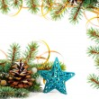 Christmas tree branch with gold serpentine and star — Foto de Stock